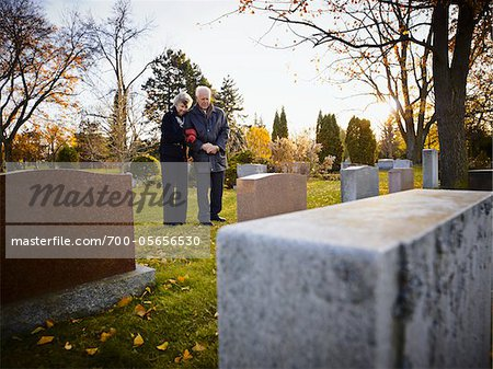 Couple Grieving in Cemetery Stock Photo - Rights-Managed, Image code: 700-05656530