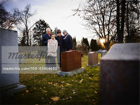 Family Grieving in Cemetery Stock Photo - Rights-Managed, Image code: 700-05656533