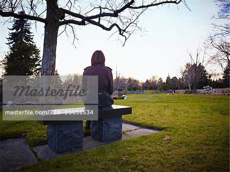 Woman Sitting on Bench in Cemetery Stock Photo - Rights-Managed, Image code: 700-05656534