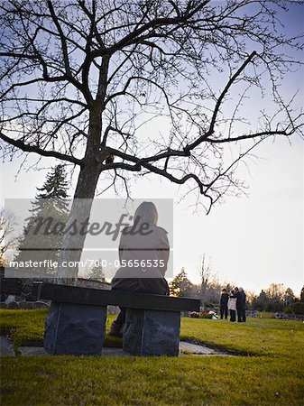 Family Grieving in Cemetery Stock Photo - Rights-Managed, Image code: 700-05656535