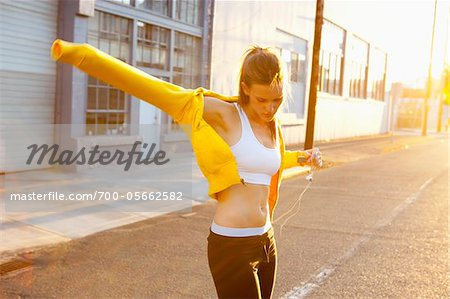 Runner Putting on Sweatshirt Stock Photo - Rights-Managed, Image code: 700-05662582