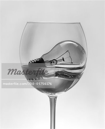Light Bulb Soaking in Water in Wine Glass Stock Photo - Rights-Managed, Image code: 700-05756176