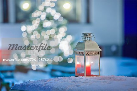 Candle Lantern Outdoors in front of Christmas Tree Stock Photo - Rights-Managed, Image code: 700-05762114