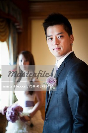 Portrait of Groom with Bride in Background Stock Photo - Rights-Managed, Image code: 700-05786434