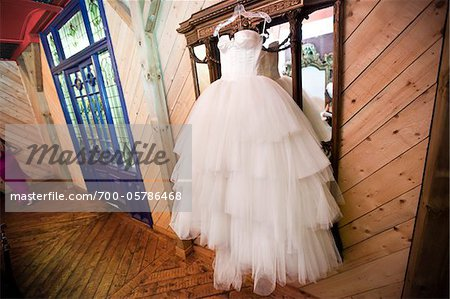 Wedding Gown Hanging in front of Mirror Stock Photo - Rights-Managed, Image code: 700-05786468