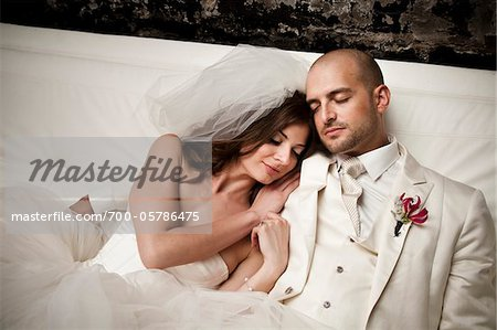 Bride and Groom Cuddling Stock Photo - Rights-Managed, Image code: 700-05786475