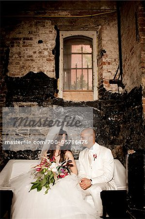 Bride and Groom Sitting Together Stock Photo - Rights-Managed, Image code: 700-05786476