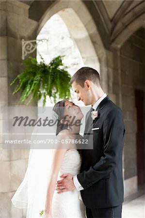 Bride and Groom Looking at Each Other Stock Photo - Rights-Managed, Image code: 700-05786622