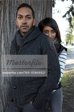 Couple Standing near Tree Stock Photo - Rights-Managed, Image code: 700-05800517