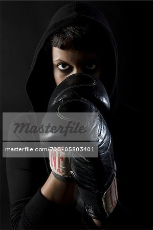 Woman Wearing Boxing Gloves and Hoodie Stock Photo - Rights-Managed, Image code: 700-05803401