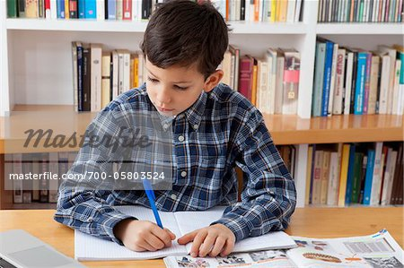 Boy Doing Homework Stock Photo - Rights-Managed, Image code: 700-05803524
