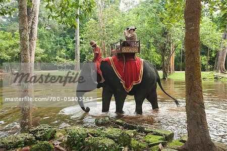 People Riding Elephant, Bayon Temple, Angkor Thom, Siem Reap, Cambodia Stock Photo - Rights-Managed, Image code: 700-05803542