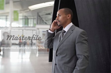 Businessman Using Cell Phone in Airport Stock Photo - Rights-Managed, Image code: 700-05821753