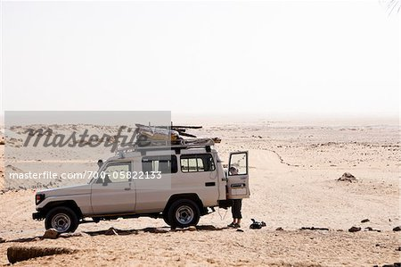 Woman with Jeep at Ain Serru, White Desert, Egypt Stock Photo - Rights-Managed, Image code: 700-05822133