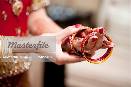 Bride Putting on Bracelets Stock Photo - Rights-Managed, Image code: 700-05855075