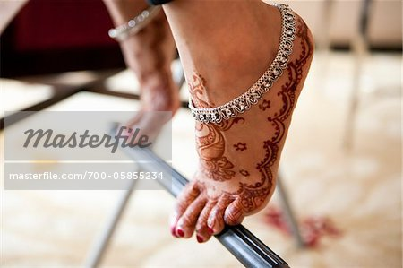 Close-Up of Bride on Tip-Toes Stock Photo - Rights-Managed, Image code: 700-05855234