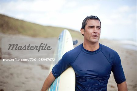 Portrait of Surfer at Beach Stock Photo - Rights-Managed, Image code: 700-05947672