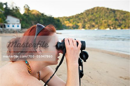 Woman with Binoculars on Beach, near Paraty, Costa Verde, Rio de Janeiro, Brazil Stock Photo - Rights-Managed, Image code: 700-05947860