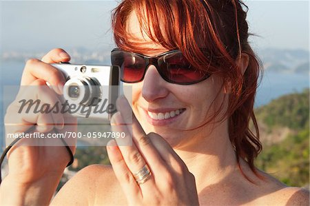 Woman Taking Photograph, Rio de Janeiro, Brazil Stock Photo - Rights-Managed, Image code: 700-05947890