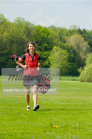 Woman Carrying Golf Bag Stock Photo - Rights-Managed, Image code: 700-05969957