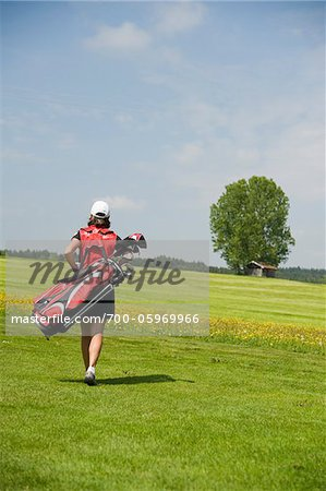 Woman Carrying Golf Bag Stock Photo - Rights-Managed, Image code: 700-05969966