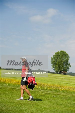 Woman Carrying Golf Bag Stock Photo - Rights-Managed, Image code: 700-05969967