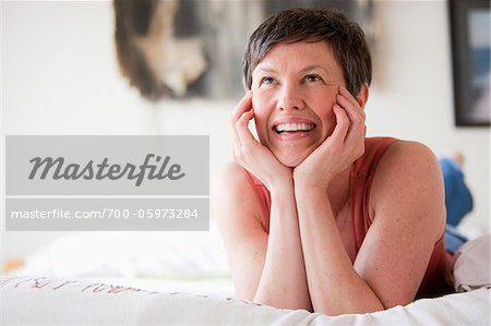 Portrait of Woman Smiling Stock Photo - Rights-Managed, Image code: 700-05973284