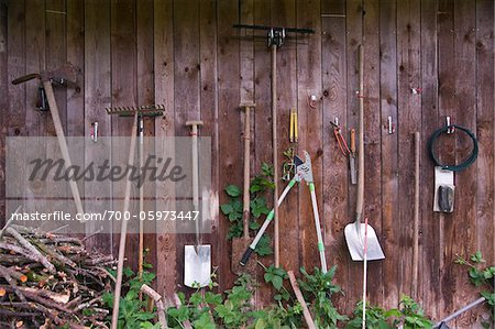 Garden Tools Hanging on Wall Stock Photo - Rights-Managed, Image code: 700-05973447
