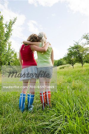 Rearview of Two Teenage Girls Outdoors Stock Photo - Rights-Managed, Image code: 700-05973469