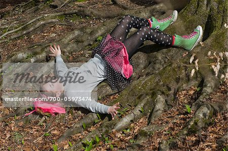 Teenage Girl Lying on Tree Roots Stock Photo - Rights-Managed, Image code: 700-05973474