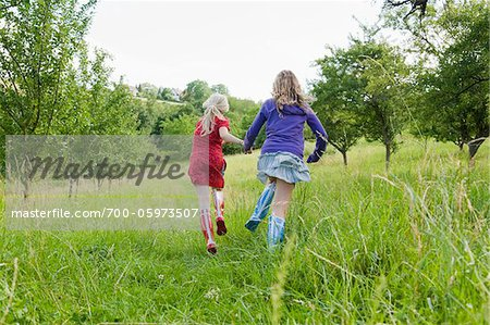 Two Girls Running in Field Stock Photo - Rights-Managed, Image code: 700-05973507