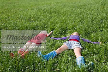 Two Girls Lying in Grass Stock Photo - Rights-Managed, Image code: 700-05973509