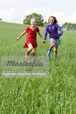 Two Girls Running in Field Stock Photo - Rights-Managed, Image code: 700-05973513