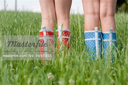 Close-Up of Girls Wearing Rubber Boots Stock Photo - Rights-Managed, Image code: 700-05973515