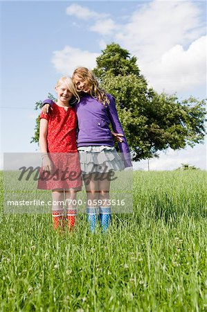 Portrait of Two Girls Standing in Field Stock Photo - Rights-Managed, Image code: 700-05973516
