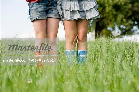 Close-Up of Girls Wearing Rubber Boots Stock Photo - Rights-Managed, Image code: 700-05973517