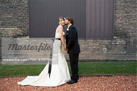 Groom Kissing Bride on Cheek Stock Photo - Rights-Managed, Image code: 700-05973647