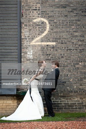 Bride and Groom with Number Two Painted on Brick Wall Stock Photo - Rights-Managed, Image code: 700-05973651