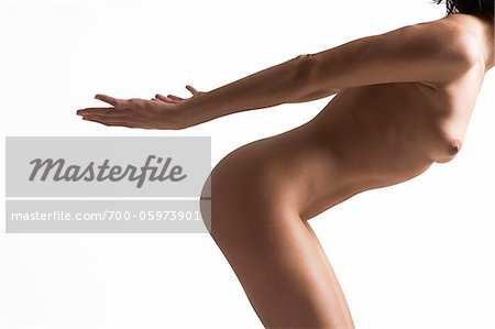 Side-View of Woman in Studio Stock Photo - Rights-Managed, Image code: 700-05973901