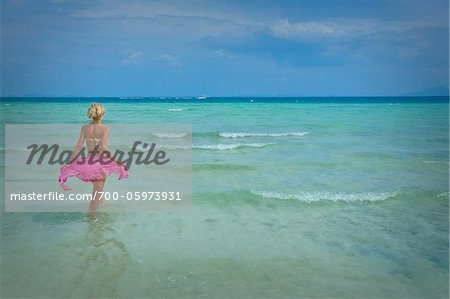 Woman on Wading in Ocean, Krabi, Thailand Stock Photo - Rights-Managed, Image code: 700-05973931