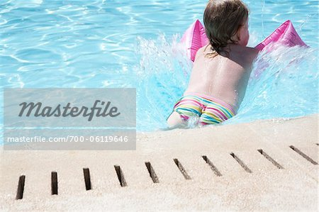 Little Girl in Swimming Pool Stock Photo - Rights-Managed, Image code: 700-06119646