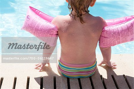 Little Girl Sitting Poolside Stock Photo - Rights-Managed, Image code: 700-06119647