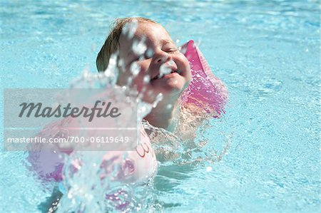 Little Girl Wearing Water Wings in Swimming Pool Stock Photo - Rights-Managed, Image code: 700-06119649