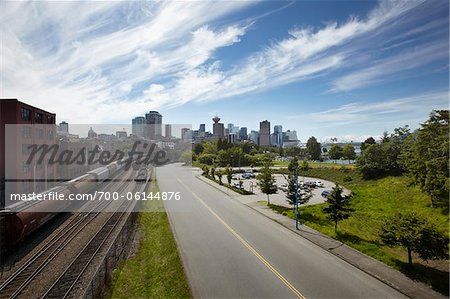 Road and Traintracks with Vancouver Skyline, Vancouver, British Columbia, Canada Stock Photo - Rights-Managed, Image code: 700-06144876