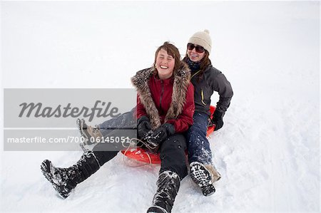 Teenage Girls Tobogganing Stock Photo - Rights-Managed, Image code: 700-06145051
