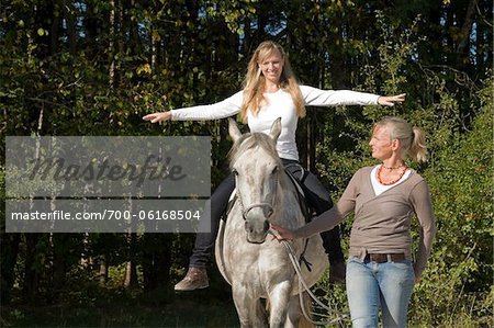 Women Riding Horse Stock Photo - Rights-Managed, Image code: 700-06168504
