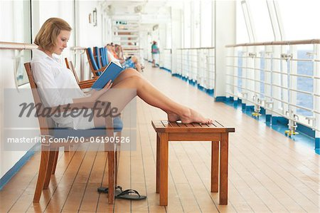 Teenage Girl Reading Book on Cruise Ship Stock Photo - Rights-Managed, Image code: 700-06190526