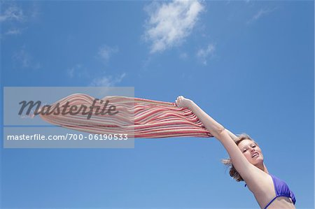 Teenage Girl Holding Scarf Out in Wind Stock Photo - Rights-Managed, Image code: 700-06190533