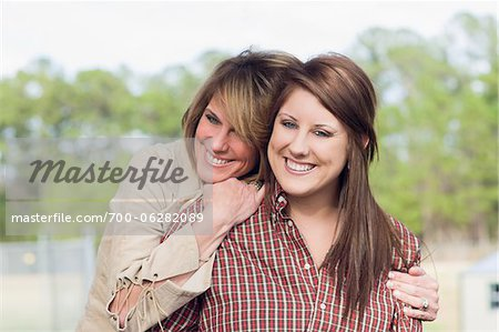 Mother and Daughter Hugging Outdoors Stock Photo - Rights-Managed, Image code: 700-06282089