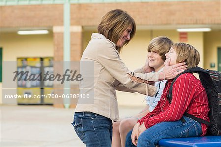 Mother with her Sons at School Stock Photo - Rights-Managed, Image code: 700-06282100